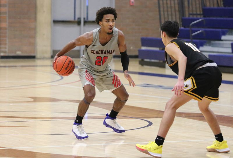 PMG PHOTO: JIM BESEDA - Clackamas Community College point guard Robert Ford scored a career-high 39 points with 10 rebounds and nine assists, leading the Cougars to a 91-71 home win Friday over Walla Walla.