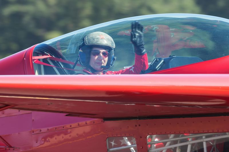 PMG FILE PHOTO - Jacquie Warda waves to the crowd in her Extra 300 during the Oregon International Air Show in Hillsboro on Sept. 24, 2017.