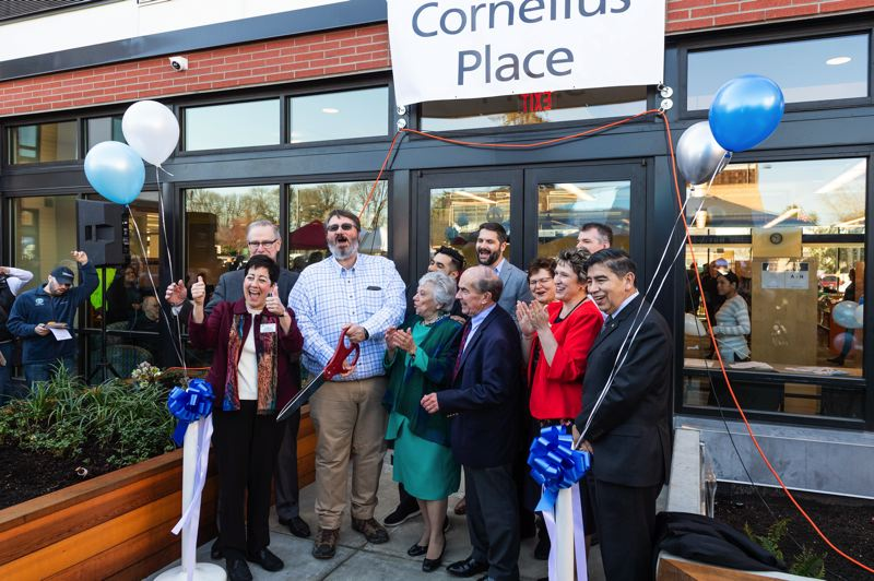 PMG FILE PHOTO - Local officials and other dignitaries celebrate after Cornelius Mayor Jef Dalin cuts the ribbon at the grand opening of Cornelius Place, the new home of the Cornelius Public Library, on March 30, 2019.