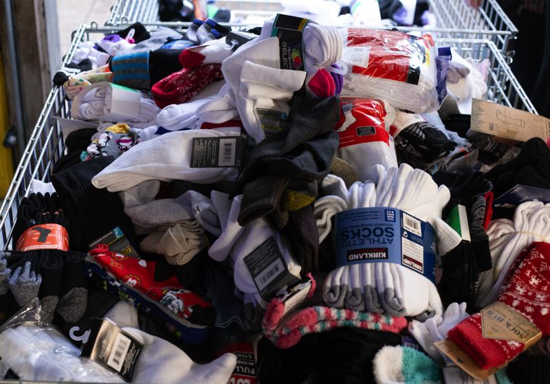 COURTESY: ADVENTIST HEALTH - Pairs of new socks, along with cans of food, were the admission price for those who attended a holiday concert that Adventist Health organized in November. The socks were donated recently to Portland Rescue Mission.