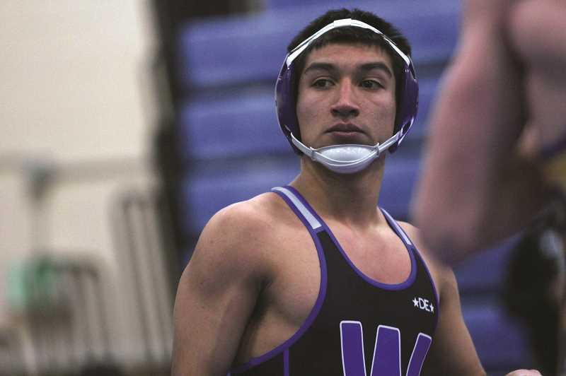PMG PHOTO: PHIL HAWKINS - Woodburn senior Hector Paniagua overpowered Hood River Valleys Preston Armstrong and picked up a third-round pin, one of two victories at 138 pounds for the Bulldogs on Wednesday.