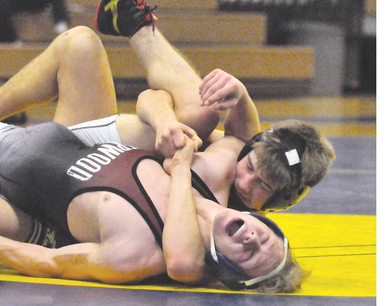 GRAPHIC PHOTO: GARY ALLEN - Sophomore Charlie Evans is among the young wrestlers leading the way for Newberg this season.