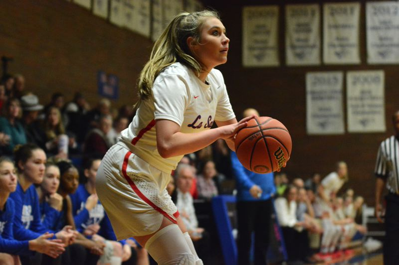PMG PHOTO: DAVID BALL - La Salle Preps Addi Wedin squares up for a 3-pointer out of the corner. She finished with four long balls and a game-high 22 points in a 61-34 win over Churchill.