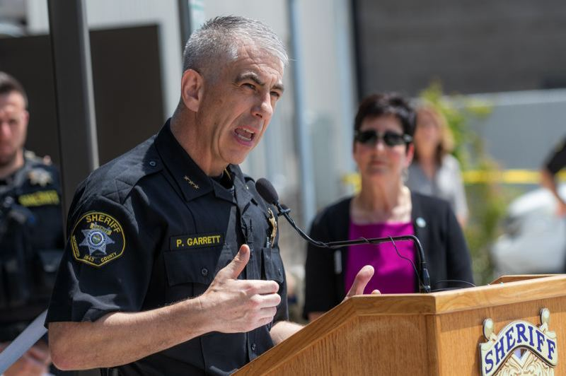 PMG FILE PHOTO - Sheriff Pat Garrett and Board Chairwoman Kathryn Harrington, in background, at the July 17 dedication of the new Washington County Sheriff's Office training center in Hillsboro. Garrett met with the board on Dec. 17 to discuss traffic stop data from a recent analysis by the Oregon Criminal Justice Commission.