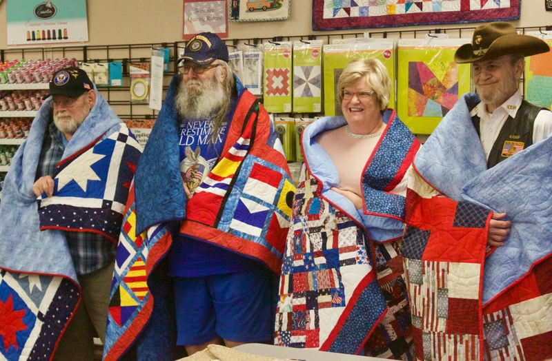 PMG PHOTO: CHRISTOPHER KEIZUR - Clive McVickor, Richard Bogges, Carolyn Anderson and Fred Shew all received their Quilts of Valor during a presentation Wednesday afternoon, Dec. 11.
