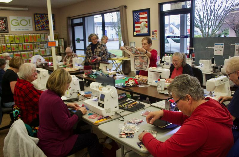 PMG PHOTO: CHRISTOPHER KEIZUR - The Gresham branch of Quilts of Valor meets monthly to stitch colorful, vibrant quilts for local veterans.