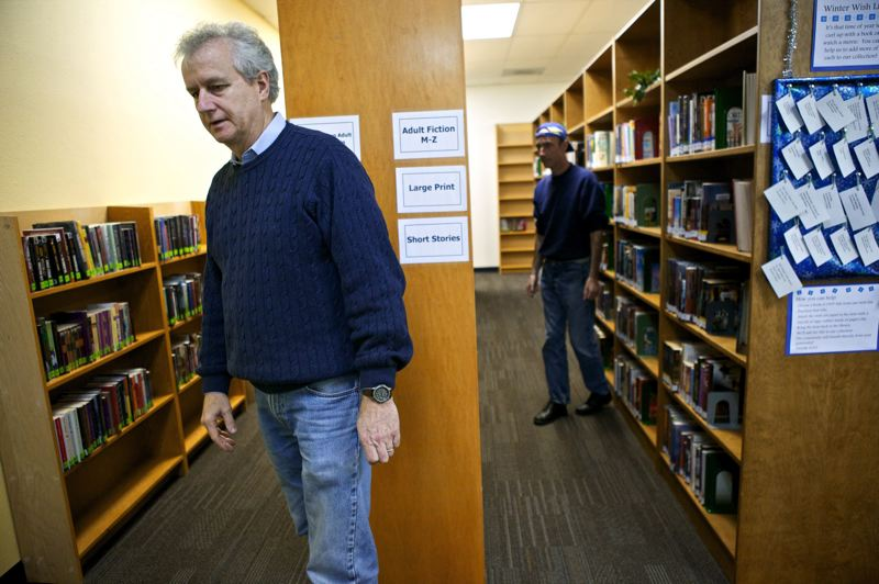 PMG FILE PHOTO - Douglas Hoy, president of the Aloha Library Association, inspects the new library in November 2012.