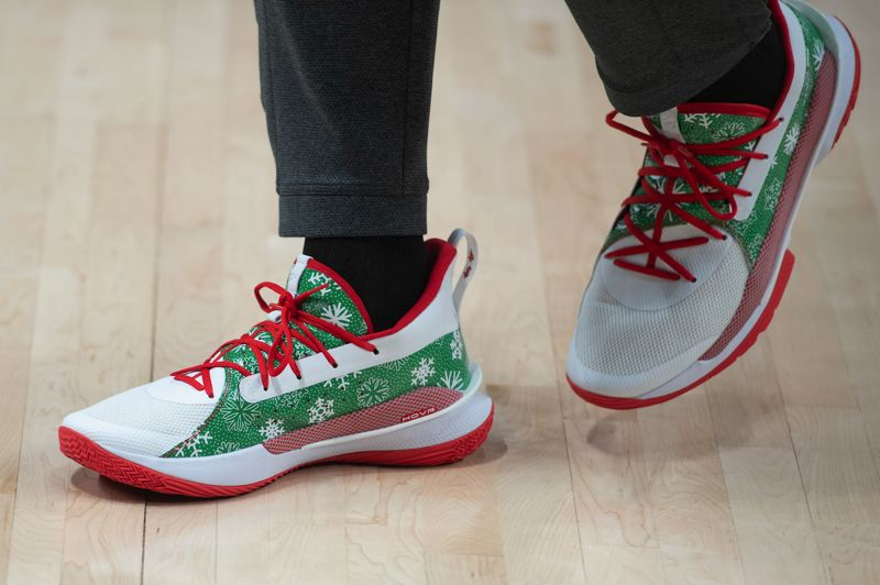 PMG PHOTO: CHRISTOPHER OERTELL - Trail Blazers forward Anthony Tolliver sports festive Under Armor shoes before the game against the New Orleans Pelicans at Moda Center on Monday.