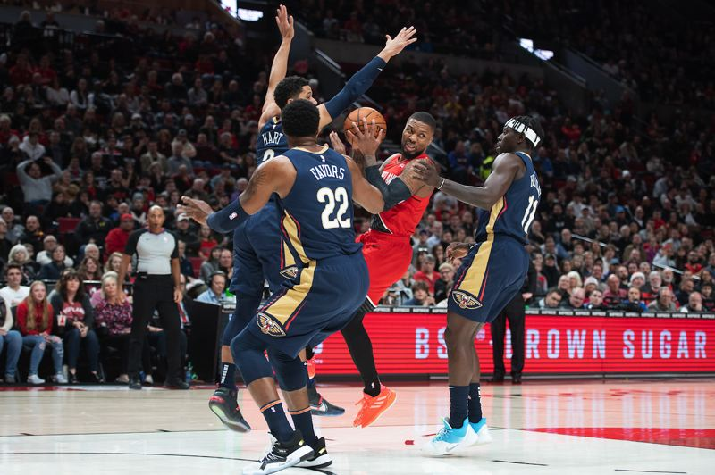 PMG PHOTO: CHRISTOPHER ONSTOTT - Trail Blazers guard Damian Lillard gets triple attention from the New Orleans Pelicans.
