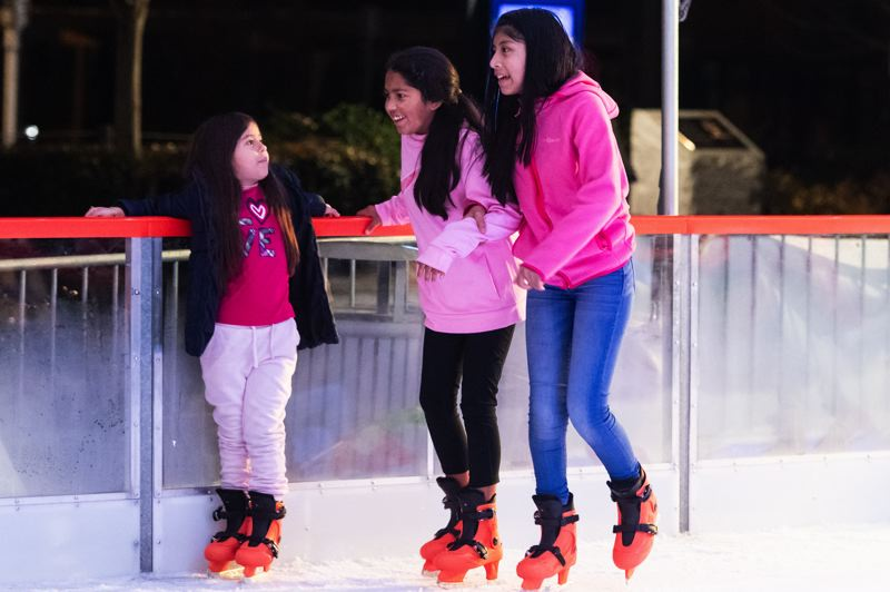 PMG PHOTO: CHRISTOPHER OERTELL - Children enjoy a skate around the rink at the Winter Village skating rink at Jerry Willey Plaza in Orenco Station in Hillsboro.