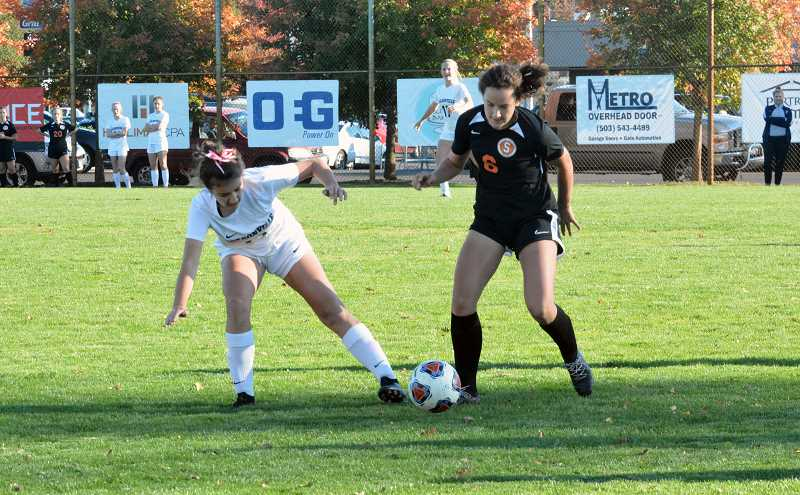 TIMES FILE PHOTO - Scappose girls soccer player Grace Negelspach and the Indians took second in the Northwest Oregon Conference.