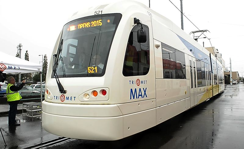 PMG FILE PHOTO - A MAX train stops at the Ruby Junction light rail facility in Gresham for a media tour in October 2014. The Type 5 train was first introduced by TriMet that fall.