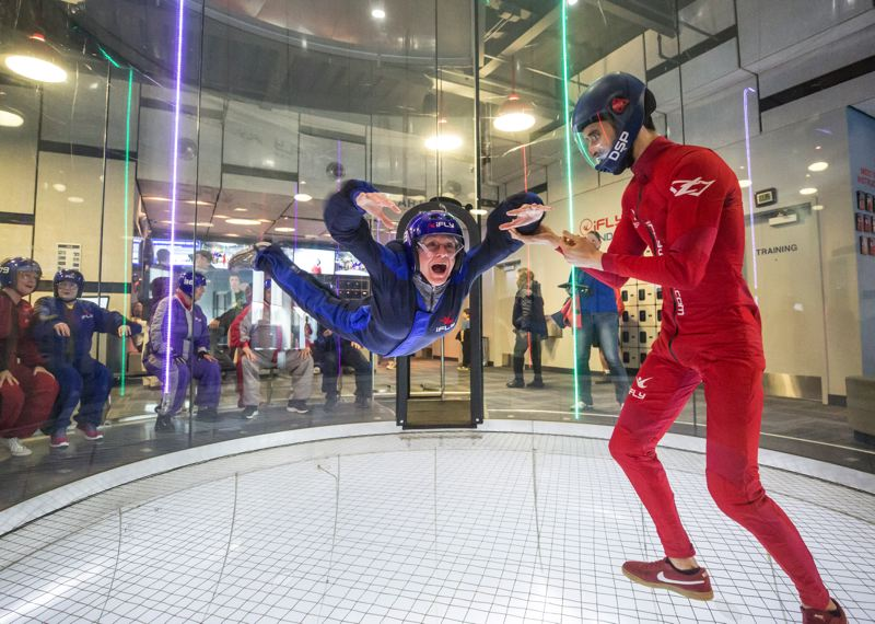 PMG FILE PHOTO - Susan Springer is surprised as she steps into the iFLY lift cylinder and begins flying, with the help of instructor David San Pedro.