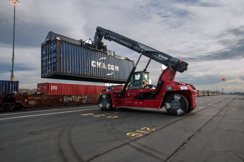 COURTESY: PORT OF PORTLAND - Terminal 4 handles more than 10,000 vehicles per month. Dockworkers and others in the auto supply chain process the imports in Portland before they are sent to dealerships across the country.
