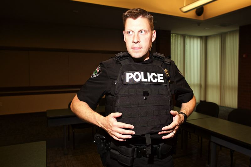 PMG FILE PHOTO - Tualatin Police Chief Bill Steele wears an armor plate vest purchased with a donation from the Tualatin Community Police Foundation in 2016.