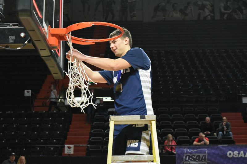 PMG FILE PHOTO - Jack Roche cuts down the net after winning the Class 5A boys basketball state title.