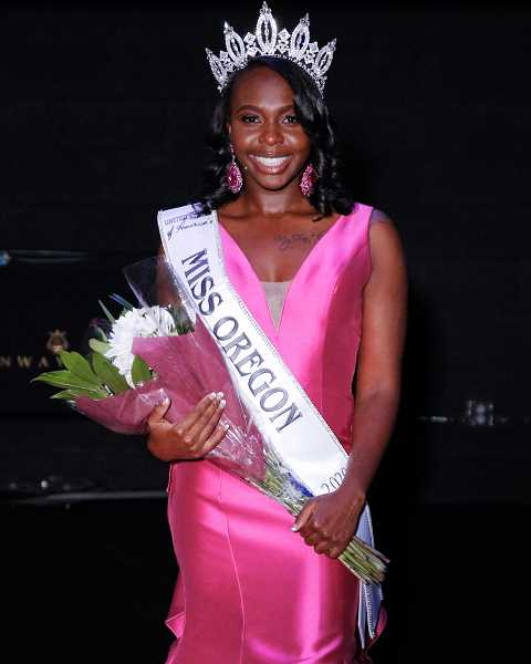 COURTESY PHOTO - Kervencia Limage shows off her crown and USOA's Miss Oregon sash shortly after winning the state pageant.