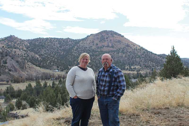 JANE AHERN/FOR THE PIONEER - Jody Nartz Holmes, left, runs the Nartz family ranch -- the 27 Bar Ranch, with help from her father, Jim Nartz. The two stand above their property in the Ashwood area., Madras Pioneer - News