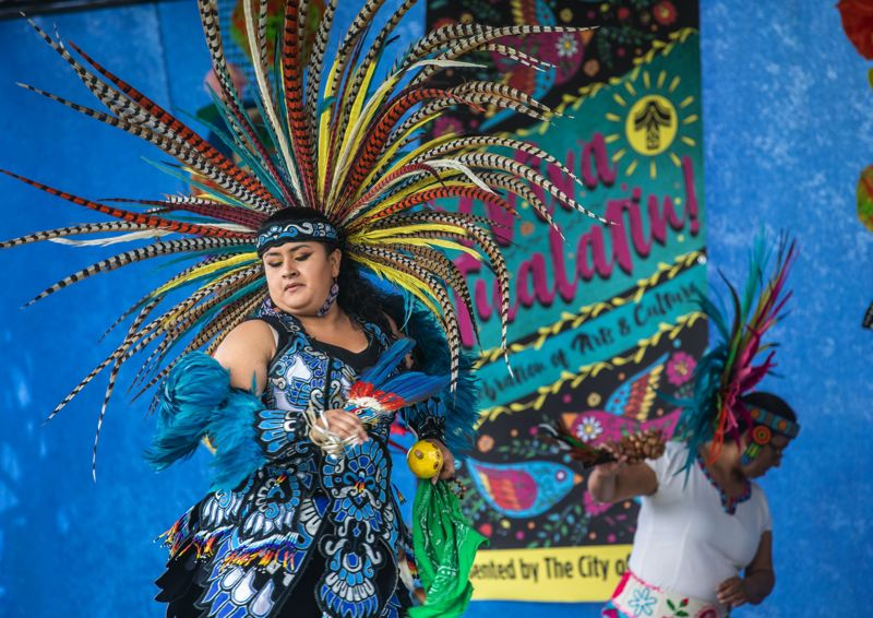 PMG PHOTO: JONATHAN HOUSE - Dancers with Danza Azteca perform at Tualatin Community Park during Viva Tualatin!
