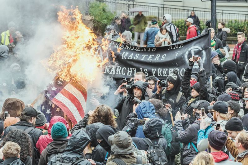 PMG PHOTO: JONATHAN HOUSE - Angry crowds surged into downtown Portland following the inauguration of President Donald Trump. It was one of several protests and rallies that have become a hallmark of Portland in this past decade.
