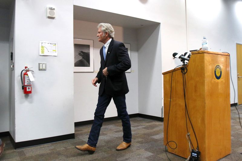 PMG FILE PHOTO - Former Oregon governor John Kitzhaber leaves the podium after talking to the media in an attempt to explain why first lady Cylvia Hayes failed to report $118,000 on her tax returns.