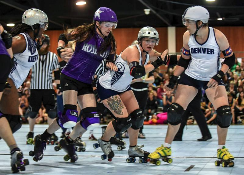 COURTESY PHOTO: CHRISTINA CAPOBIANCO - Rose City Rollers jammer Beyond Thunderdame bursts through a wall of Denver Roller Derby blockers during a tournament in May 2019.