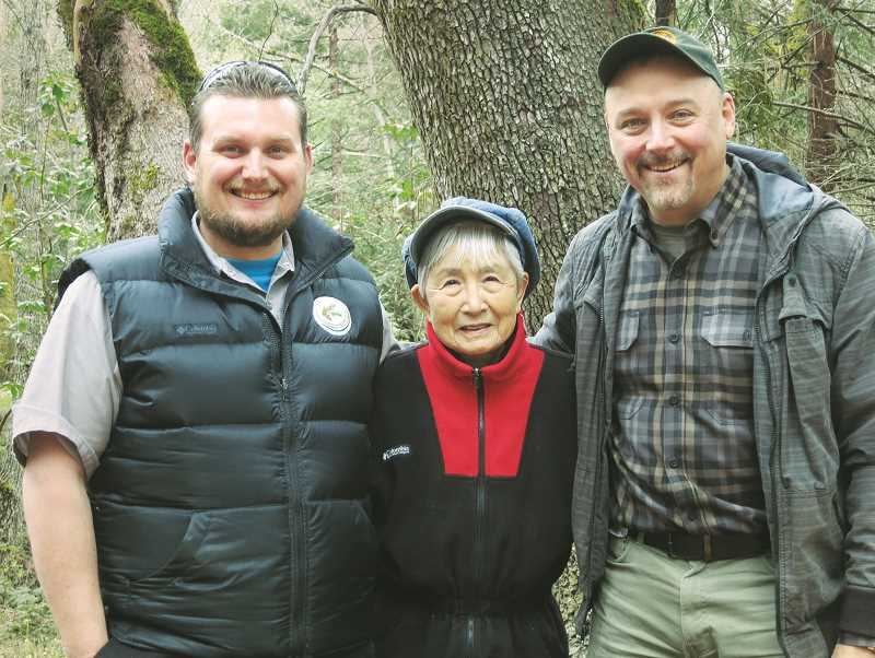 SUBMITTED PHOTO - Medford resident Hideko Tamura-Snider (center) brought seeds to Oregon that were collected from trees that survived the atomic bombing of Hiroshima in 1945. A bombing survivor herself, she got Oregon Community Trees board member Mike Oxendine (left) to germinate the seeds, with the help of ODF's Public Affairs Specialist Jim Gersbach (right).