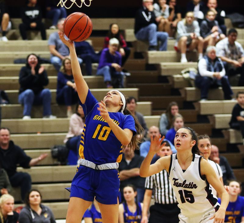 PMG PHOTO: DAN BROOD - Barlow High School senior Emily Fortin goes up to the basket during Fridays game at Tualatin. Fortin scored a game-high 18 points in the Bruins 53-43 victory.