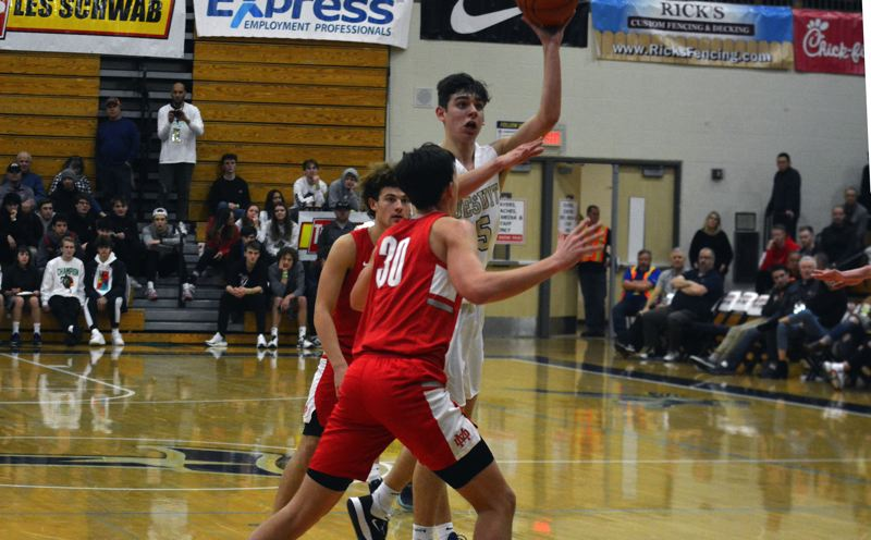 TIMES PHOTO: MATT SINGLEDECKER - Jesuit junior Liam Ruttledge scored a team-high 18 points against Mater Dei at the Les Schwab Invitational