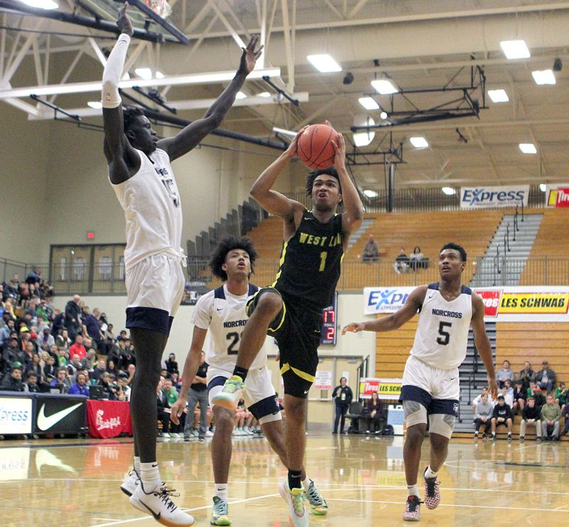 PMG PHOTO: MILES VANCE - West Linn senior Micah Garrett (shown here against Norcross) has helped the Lions to two straight wins in the Les Schwab Invitational at Liberty High School.
