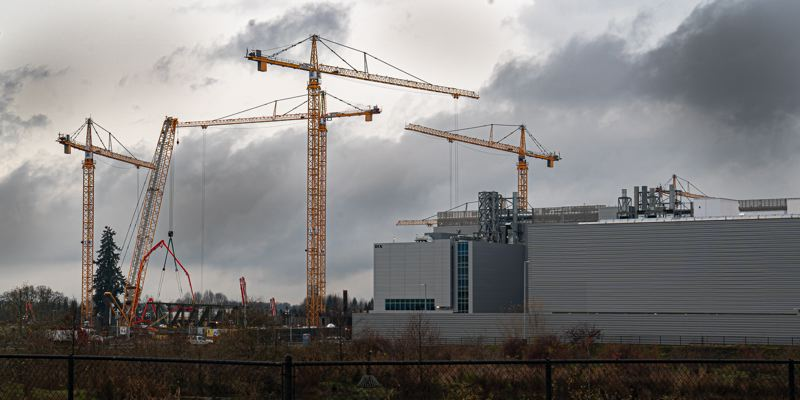 TIM HERMAN/INTEL CORPORATION - Cranes at Intel's Ronler Acres where the next big fab is going up.