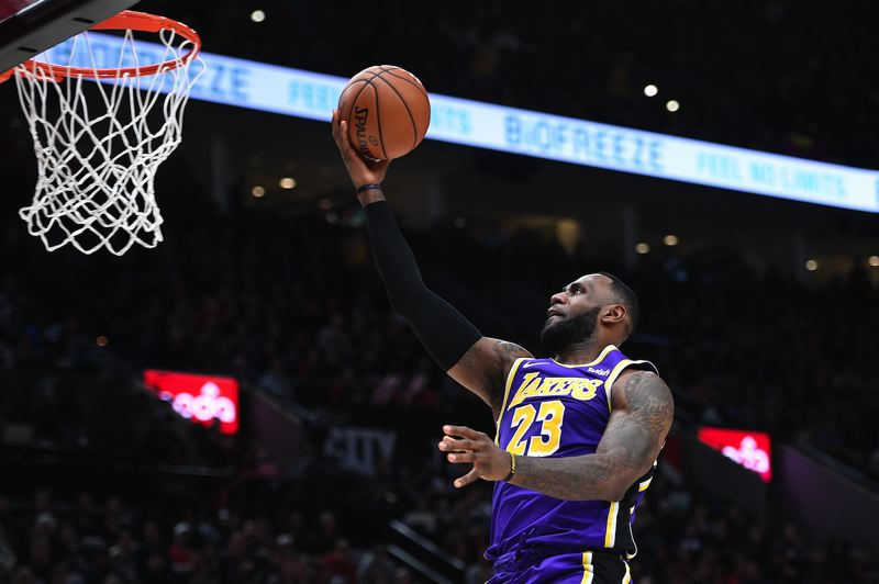 PMG PHOTO: CHRISTOPHER OERTELL - LeBron James of the Los Angeles Lakers goes to the basket on Saturday night at Moda Center.