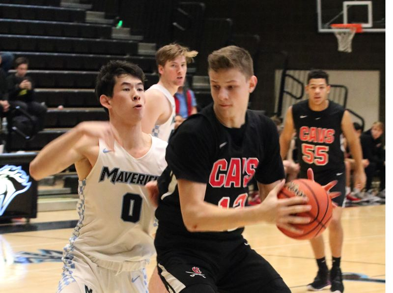 PMG MEDIA PHOTO: JIM BESEDA - Clackamas' Ben Gregg runs into resistance from Mountainside's Connor McClean in the first quarter.
