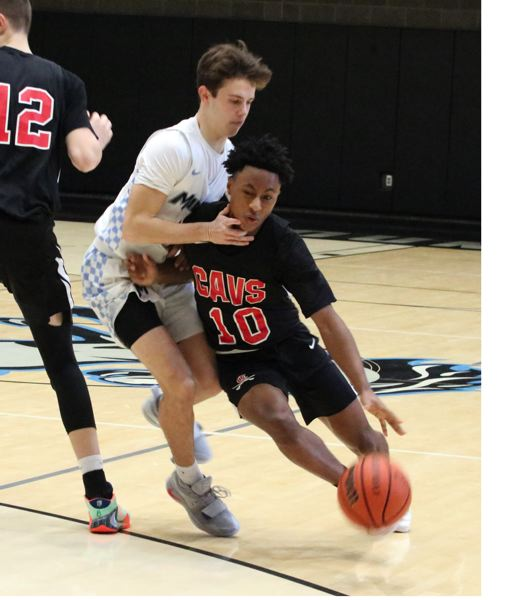PMG MEDIA PHOTO: JIM BESEDA - Clackamas K.J. Horsley (10) collides with Mountainside's Samuel Cohen on his way to the basket.