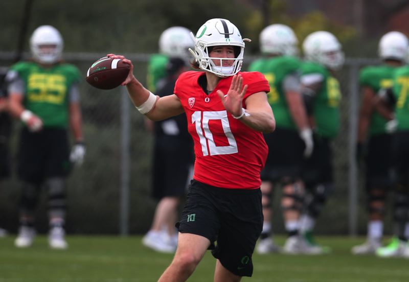 COURTESY PHOTO: CHRIS PIETSCH/REGISTER-GUARD - Oregon quarterback Justin Herbert, here practicing Sunday, is one of the Ducks' stars in the Rose Bowl.