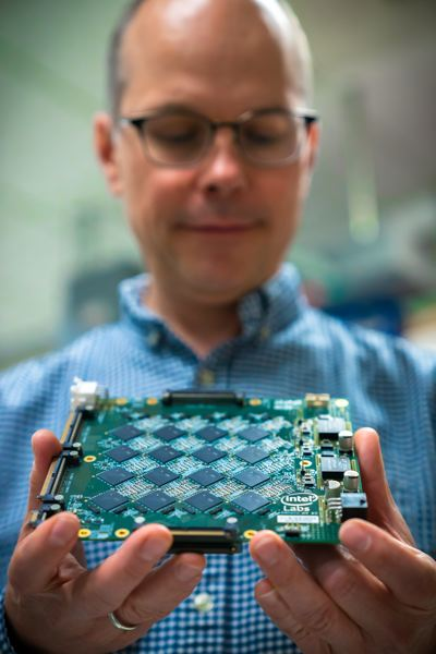 TIM HERMAN/INTEL CORPORATION - Rich Uhlig, managing director of Intel Labs, shows off a Nahuku board used in the company's R&D department where they are investigating neuromorphic computing, the next wave after Artificial Intelligence, which is supposed to simulate the way the brain makes decisions using elusive concepts such as common sense.