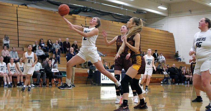 PMG PHOTO: MILES VANCE - Lake Oswego junior Emma Jeanson goes up to score during her team's 55-48 loss to Milwaukie in the first round of the Nike Interstate Shootout at Lake Oswego High School on Friday, Dec. 27.