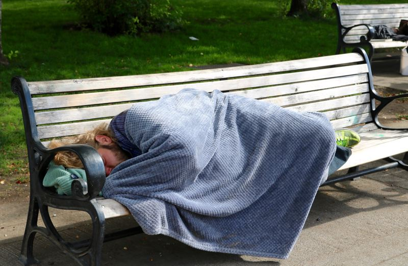 PMG PHOTO: ZANE SPARLING - A person sleeps on a park bench in downtown Portland in 2019.