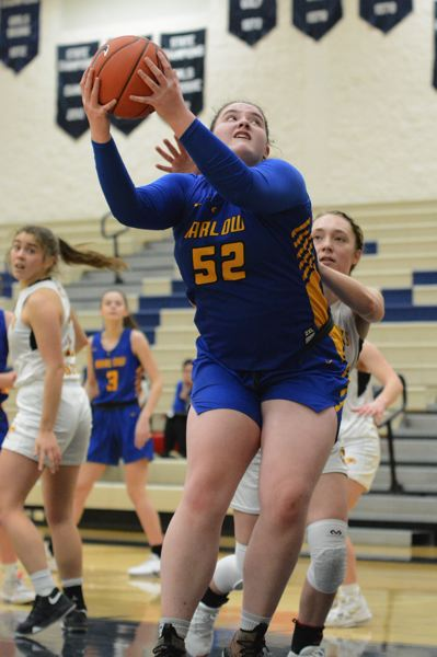 PMG PHOTO: DAVID BALL - Barlows Libby Mathis hauls in a pass and turns to the basket for two of her game-high 15 points in Mondays 64-36 win over The Dalles.