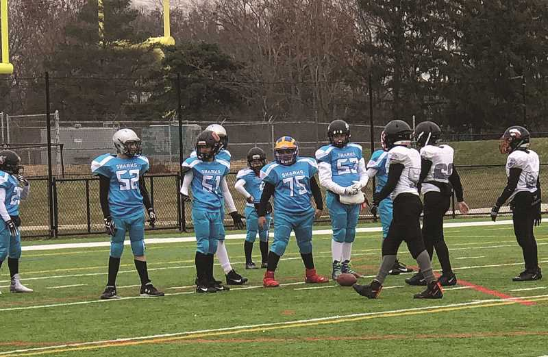 COURTESY PHOTO: RICARDO FERREIRA - Angelo said he relishes playing center, welcoming the pressure of handling the ball while being allowed to hit and be hit in the trenches of the line.
