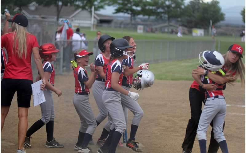STEELE HAUGEN - A Jefferson County softball team celebrates after a win. The All-Star tournament was hosted by Madras and Juniper Hills park.