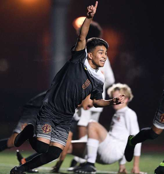 PMG PHOTO: CHRISTOPHER OERTELL - Forest Grove's Antonio Cipriano celebrates a goal during a Vikings playoff game this past season. The Viks made it to the state semifinals before losing to Summit.
