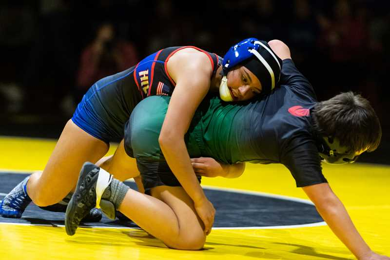 PMG PHOTO: CHRISTOPHER OERTELL - Hillsboro's Ayana Medina during a wrestling match this past season. Medina won a state championship in the 105-pound weight division.