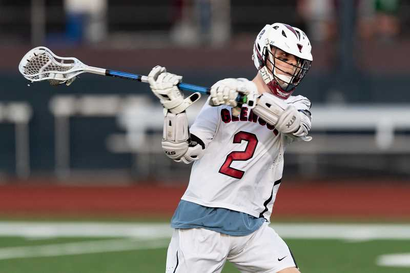 PMG PHOTO: CHRISTOPHER OERTELL - Glencoe's Thomas Takle fires a shot during a Tide game last season. The Tide boys lacrosse team were league champions before dropping a first round state playoff game.