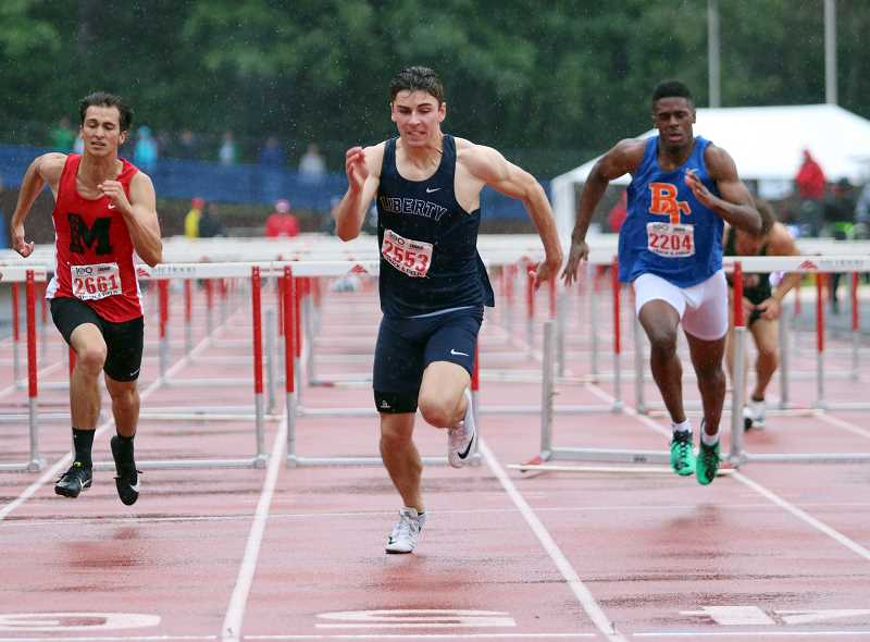 PMG PHOTO: MILES VANCE - Liberty's Aidan Maloney during the state  track meet last spring. Maloney won the state 110 meter hurdles championship and placed second in the high jump.