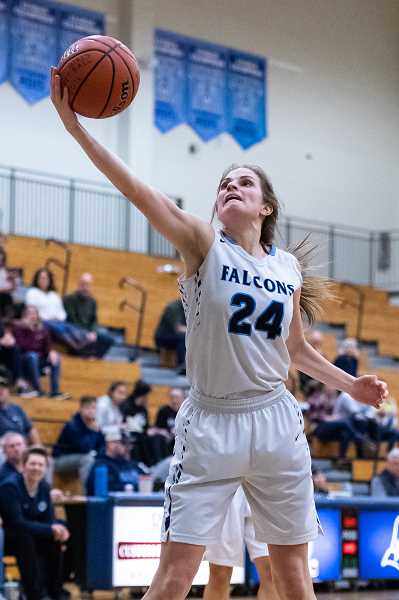 PMG PHOTO: CHRISTOPHER OERTELL - Liberty's Clara Robbins goes up for a shot during a Falcons game last season. The Falcons won a share of the Pacific Conference championship and made it to the state playoffs' second round.