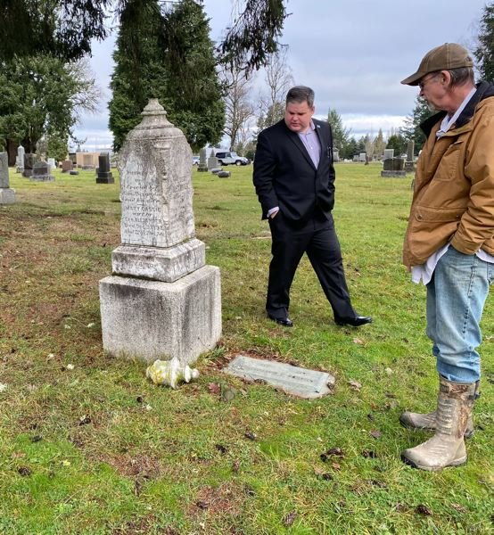 PHOTO: COURTESY OF OREGON FREEMASONS - Local freemason Bill Sparks III inspects damage to a gravestone with cemetery manager Randy Ince at the Forest View Cemetery.