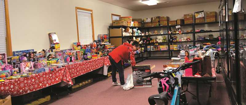 PMG PHOTO: CINDY FAMA - One of the helping elves goes through some of the toys that would make their way to local children's hands.