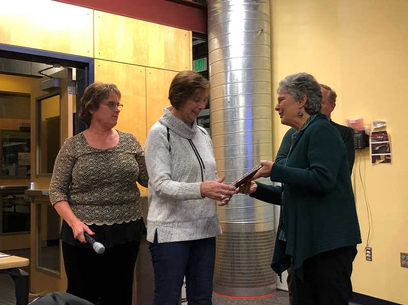 COURTESY PHOTO: CSD - Sheila Brownell, December's CARE Award winner, receives a plaque at the December school board meeting.