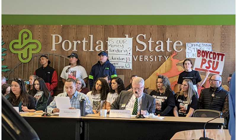 PMG FILE PHOTO - PSU's board of trustees votes in October on a new campus safety plan that includes armed police. Behind them, protestors and the family of Jason Washington show disapproval.